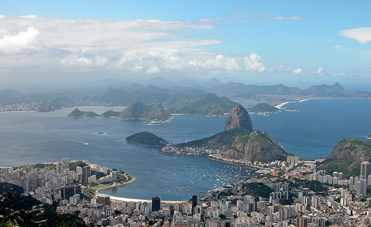 View to the Sugarloaf, Bay of Botafogo and ocean beaches in Niteroi from the Corcovado Mountain